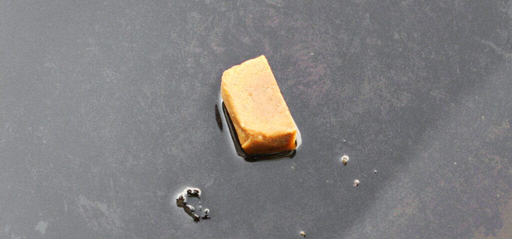 bouillon cube in a skillet with oil