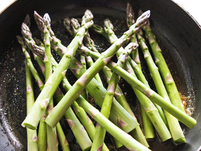 fresh asparagus in a hot skillet