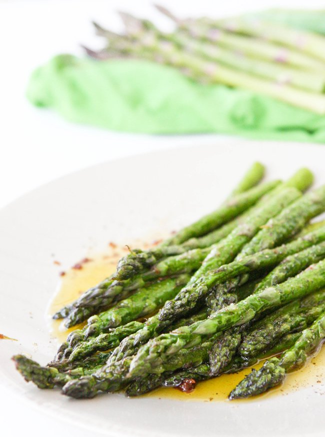 serving plate filled with cooked sauteed asparagus