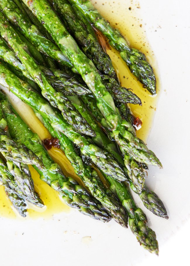 close up of sauteed asparagus on a serving plate