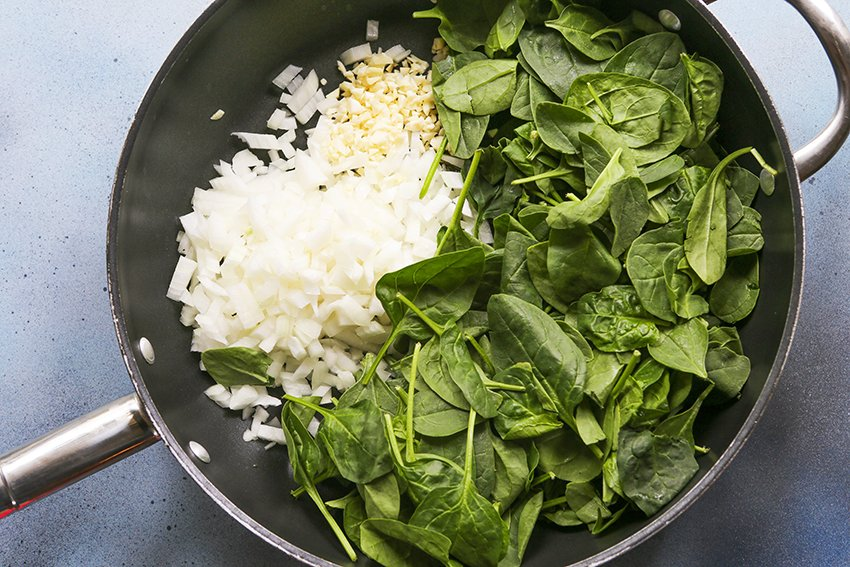 spinach, onions and garlic in a skillet