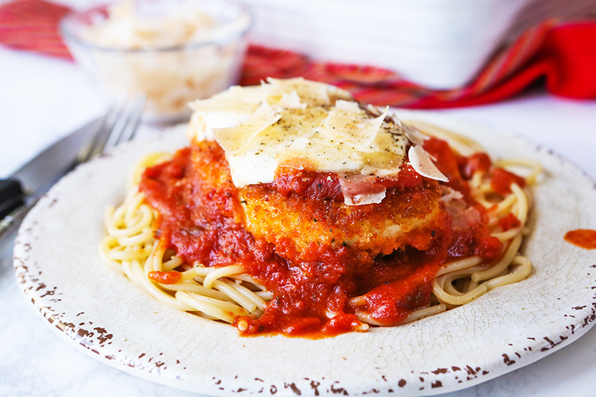 plated chicken parmesan with cheese on top