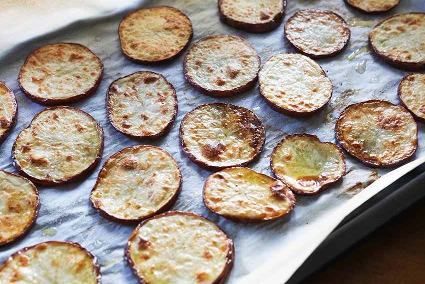 potato rounds lightly browned just out of oven