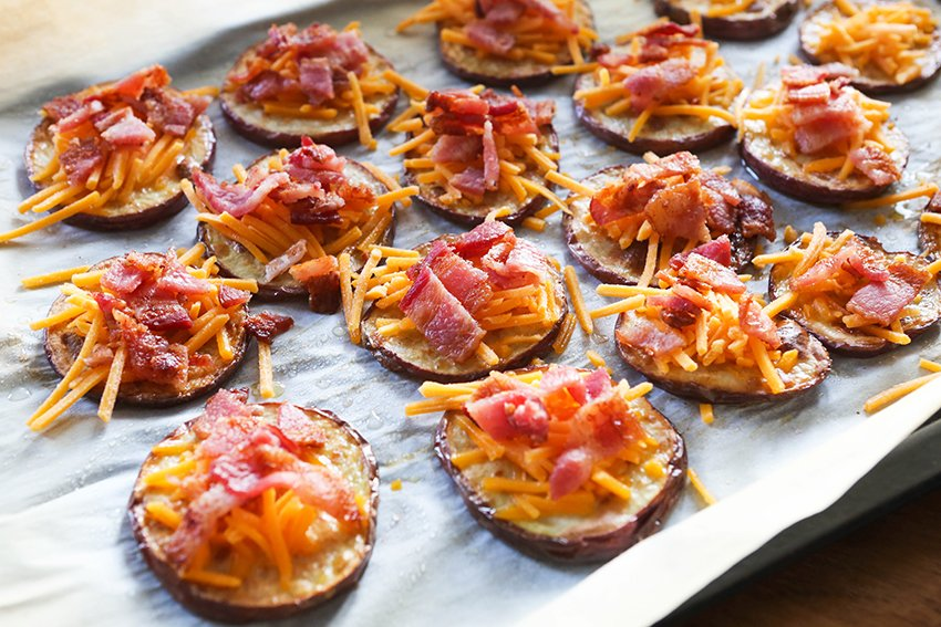 potato slices with cheese and bacon crumbles on top