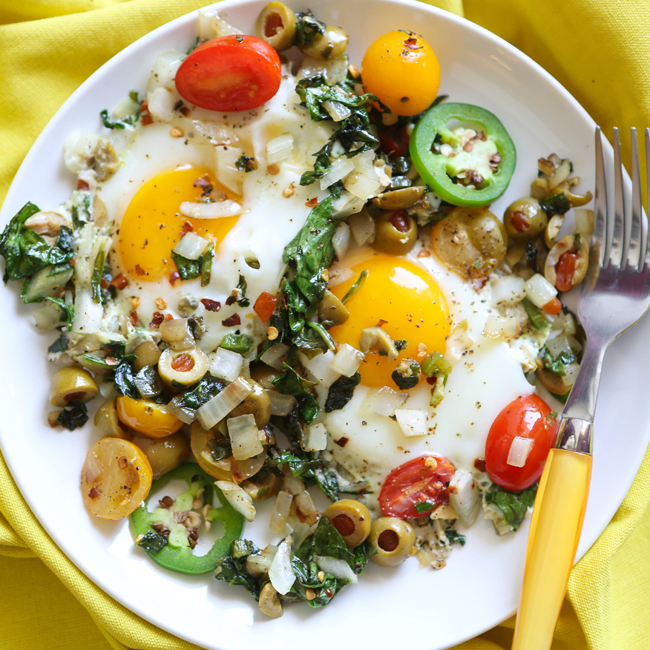 plate filled with eggs and veggies, ready to dig into