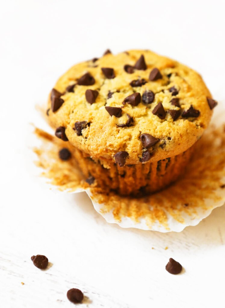 solo chocolate chip muffin sitting inside a wrapper