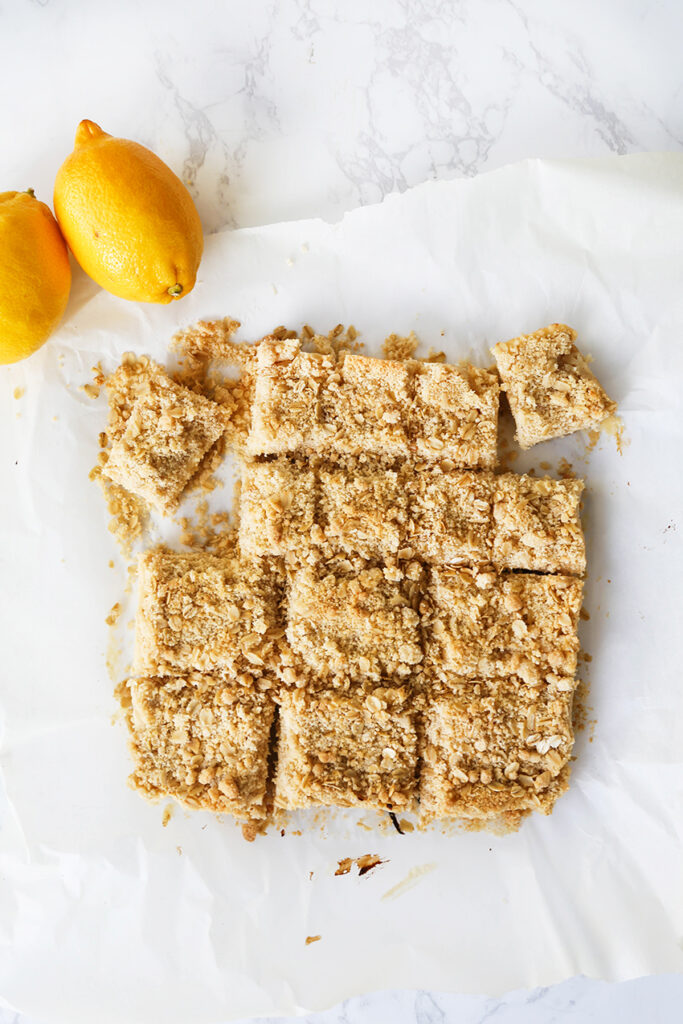 top view of crumbly bars sitting next to lemons