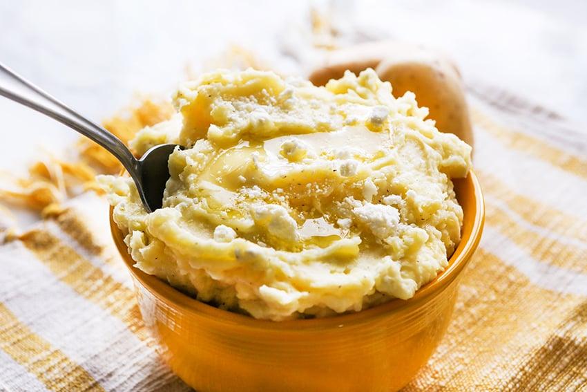 a bowl of feta mashed potatoes
