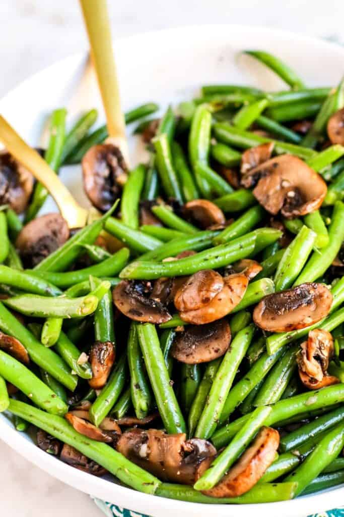 bowl of sauteed green beans with mushrooms