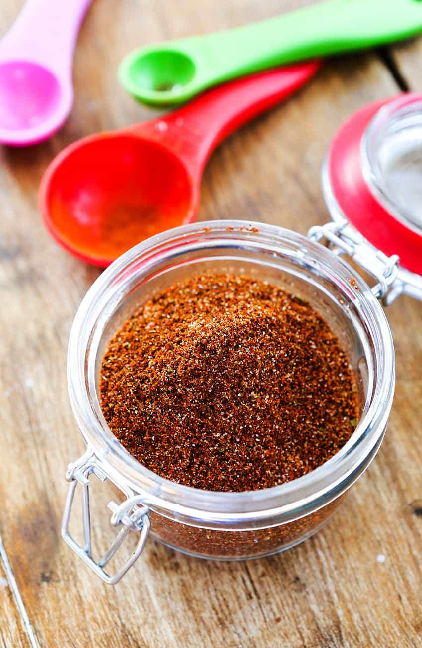 taco seasoning in a mason jar sitting on a table