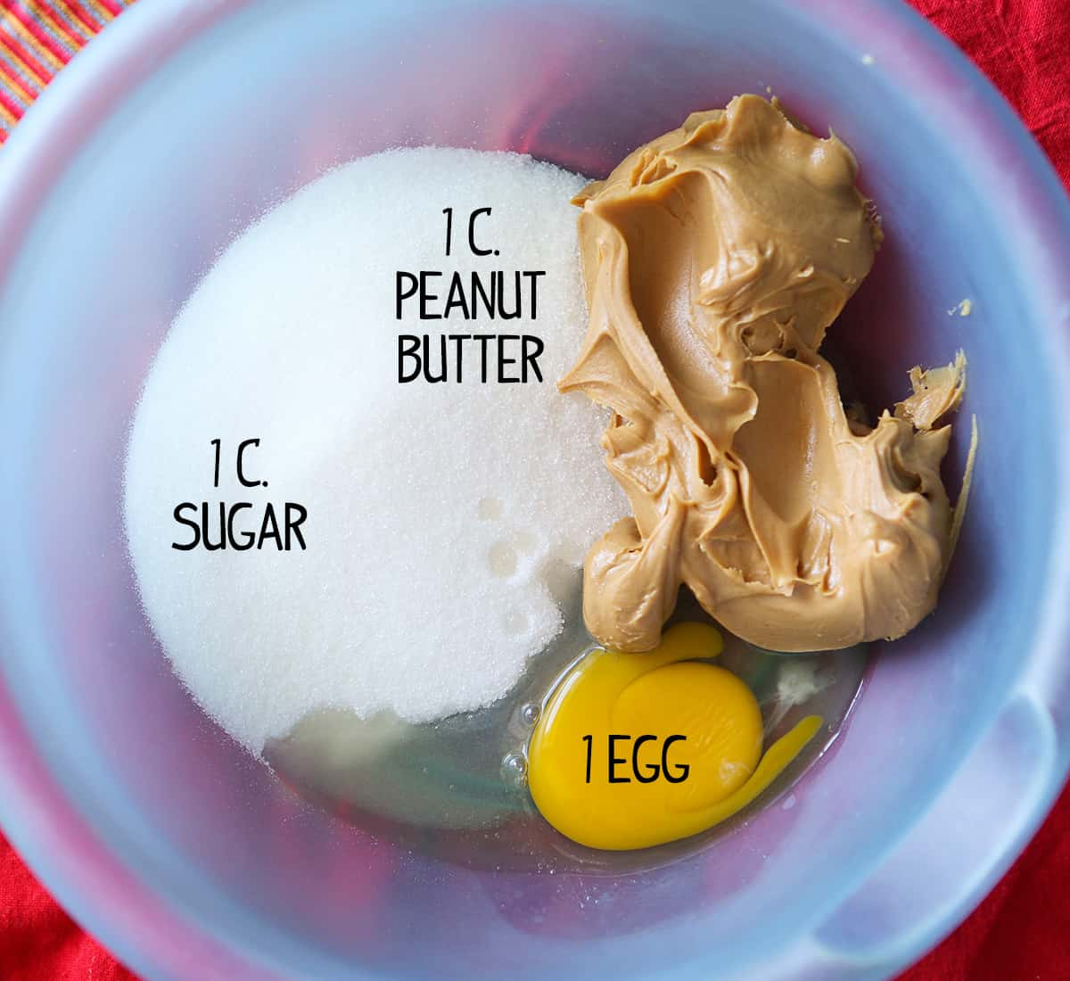 peanut butter, egg and sugar in a mixing bowl