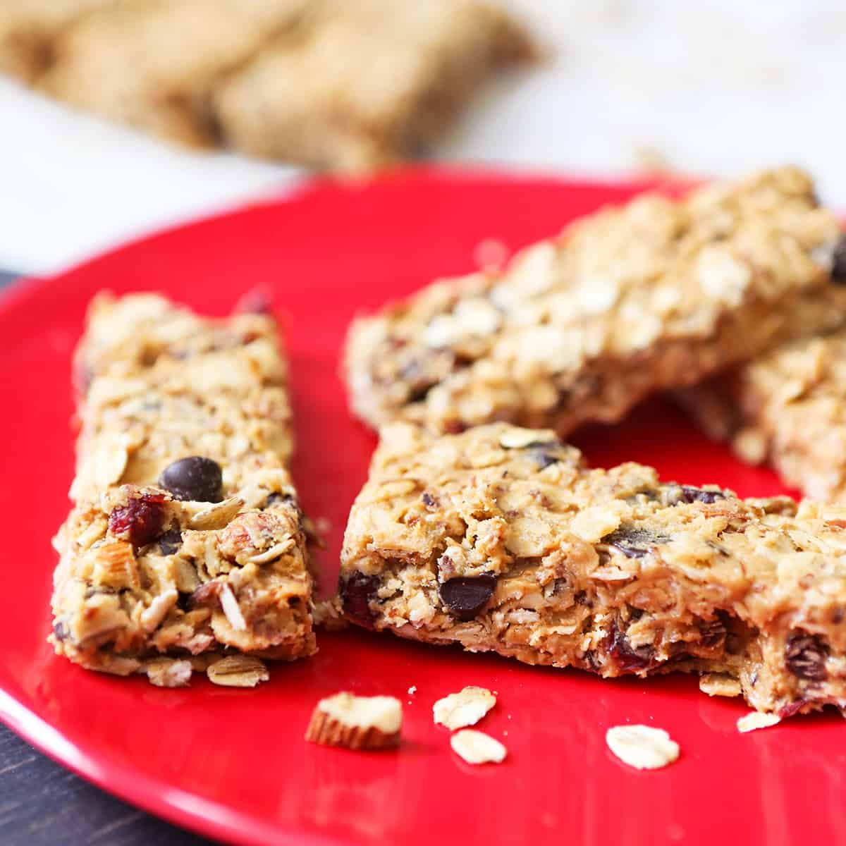 red plate with granola bars stacked on top