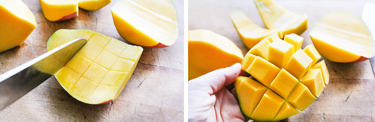 knife scoring lines into the flesh of a mango and a hand inverting the mango into pieces