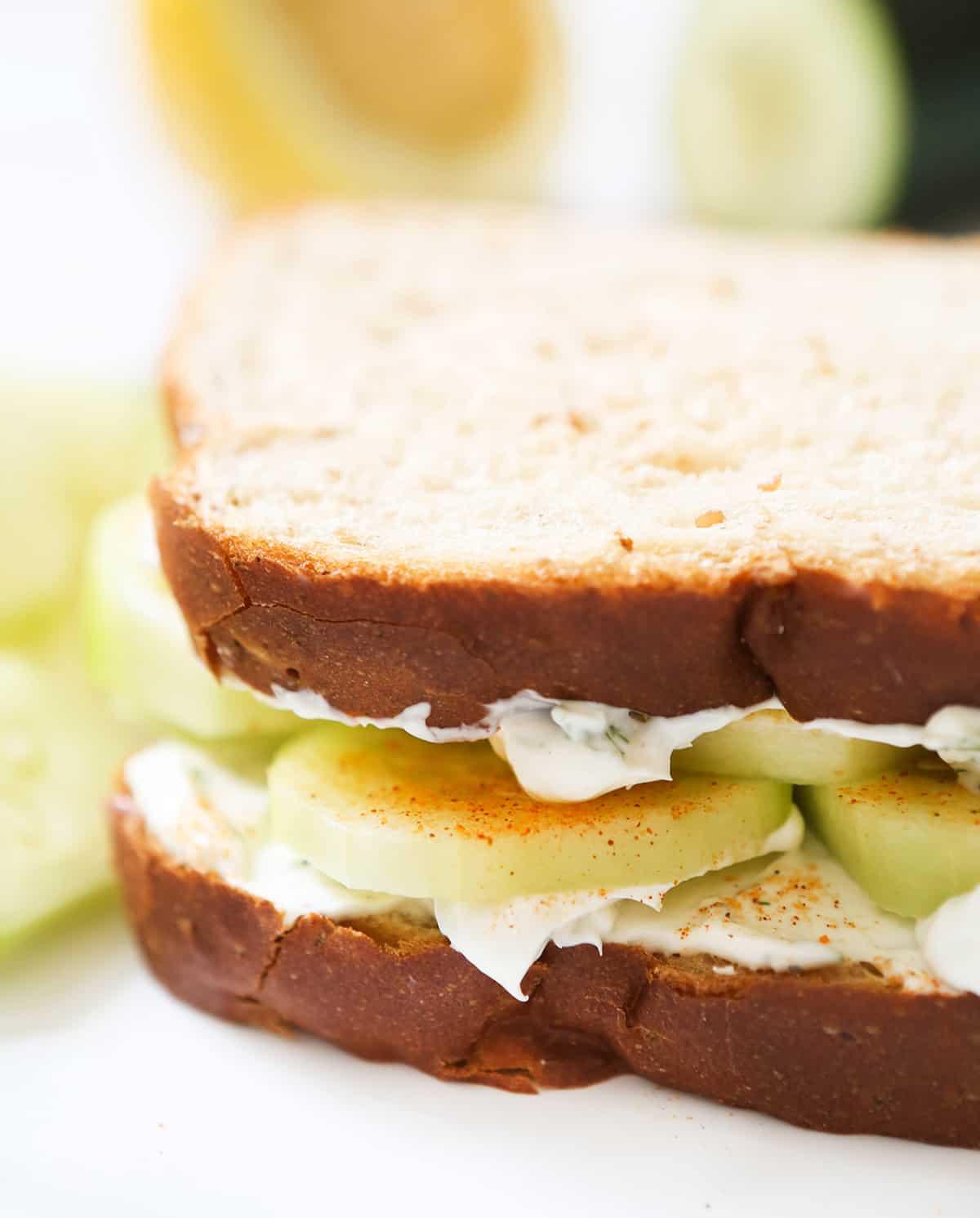 Close up of a cucumber cream cheese sandwich.