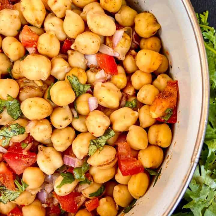 close up of a bowl full of vegan chickpea salad