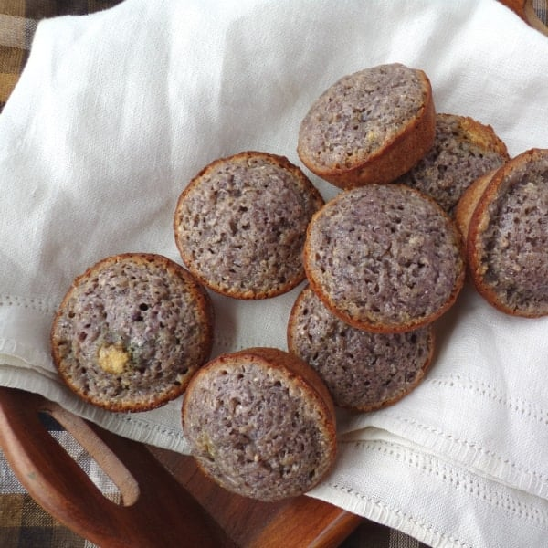blue cornbread muffins sitting inside a decorative towel