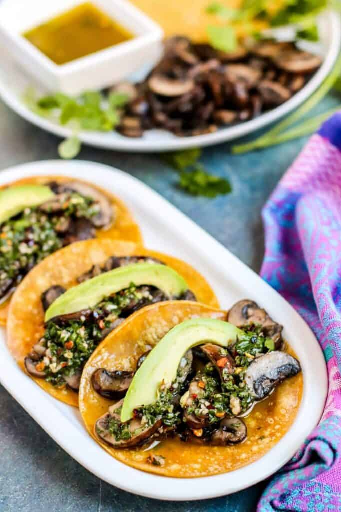 3 corn tortillas mushroom tacos drizzled with chimichurri sauce