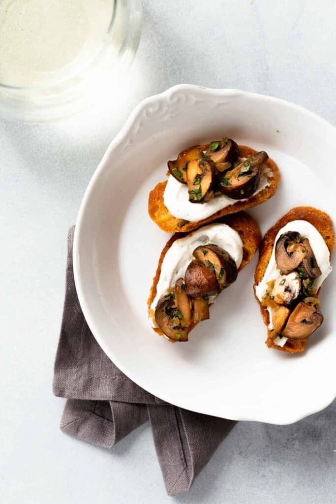 mushroom and goat cheese crostini in a bowl