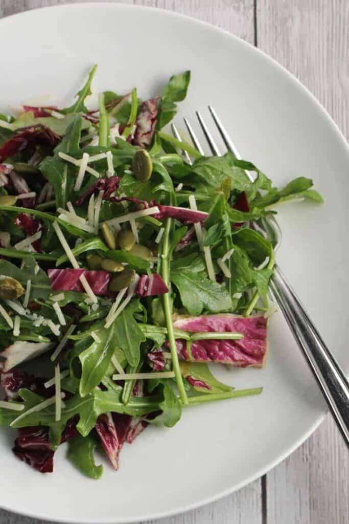 plate of arugula salad with maple vinaigrette