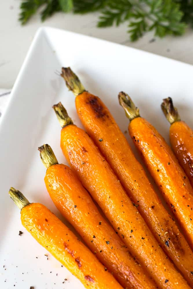 roasted carrots on a white serving platter