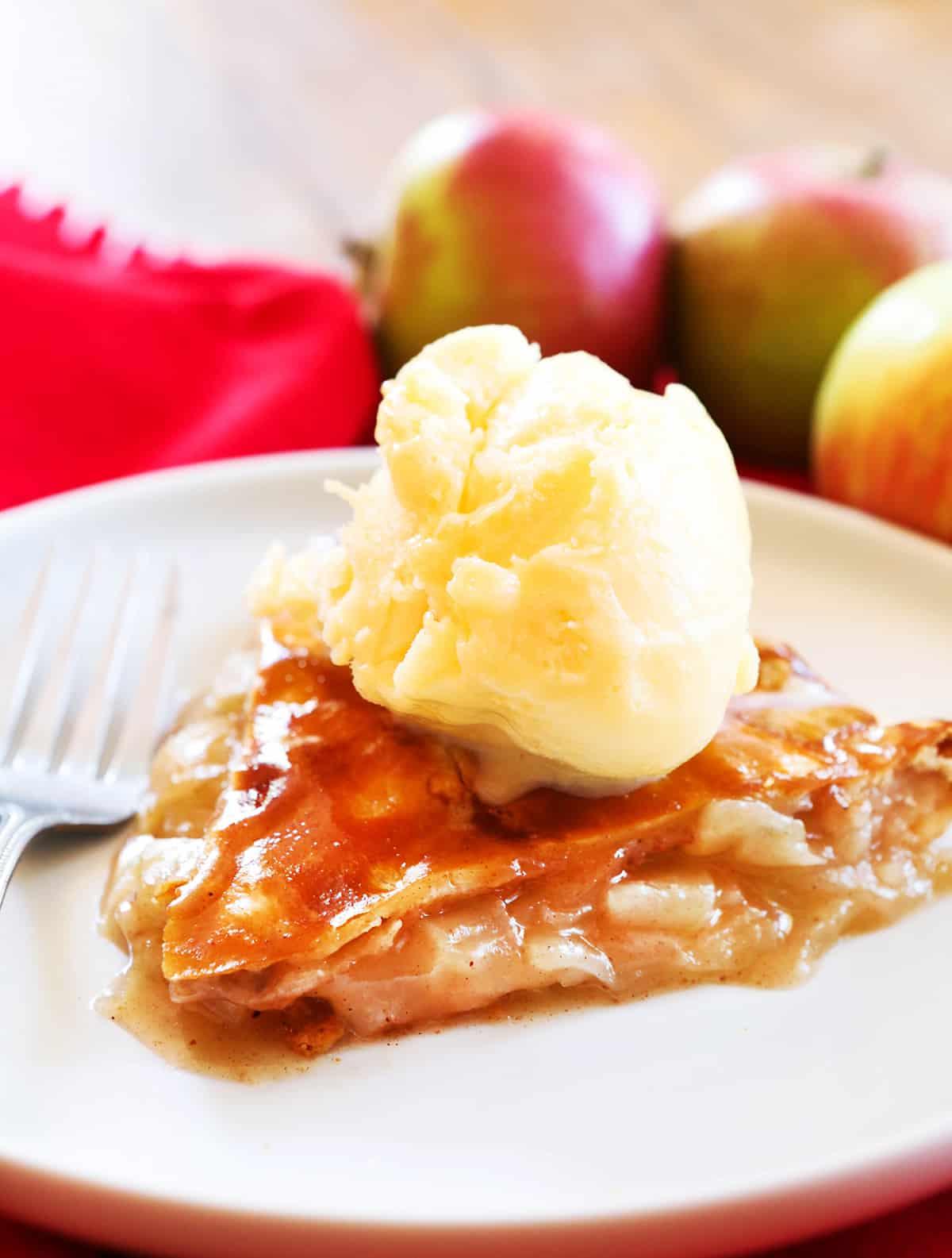 slice of easy apple pie with a scoop of vanilla ice cream on top.
