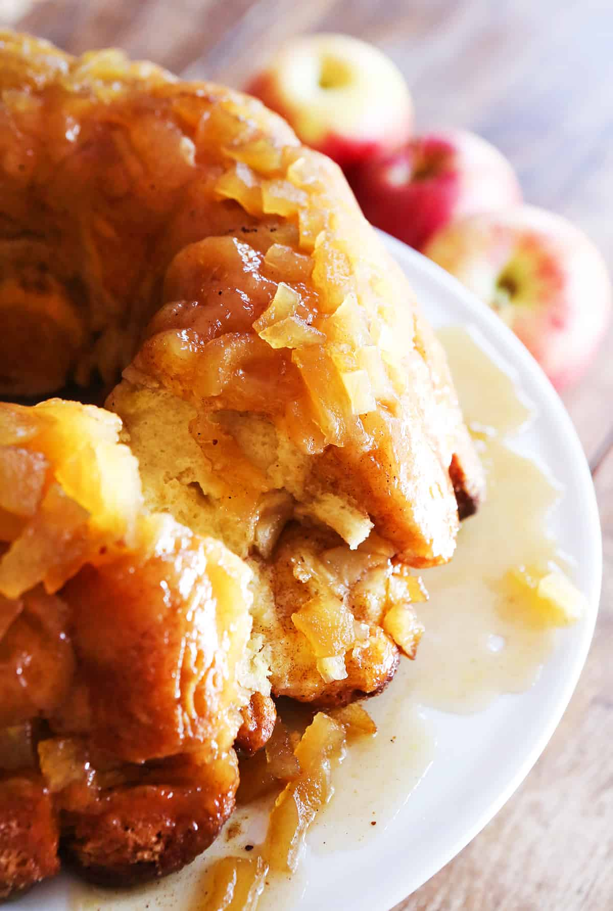 Apple pie monkey bread with a few bites pulled out from center.