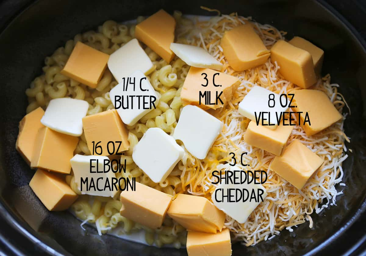 Ingredients for crockpot mac and cheese recipe inside a slow cooker.