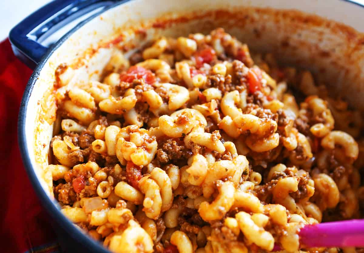 Delicious cooked pot filled with ground beef and pasta.