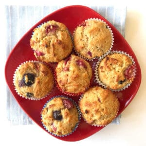 Top view of a plate full of red white and blue muffins.