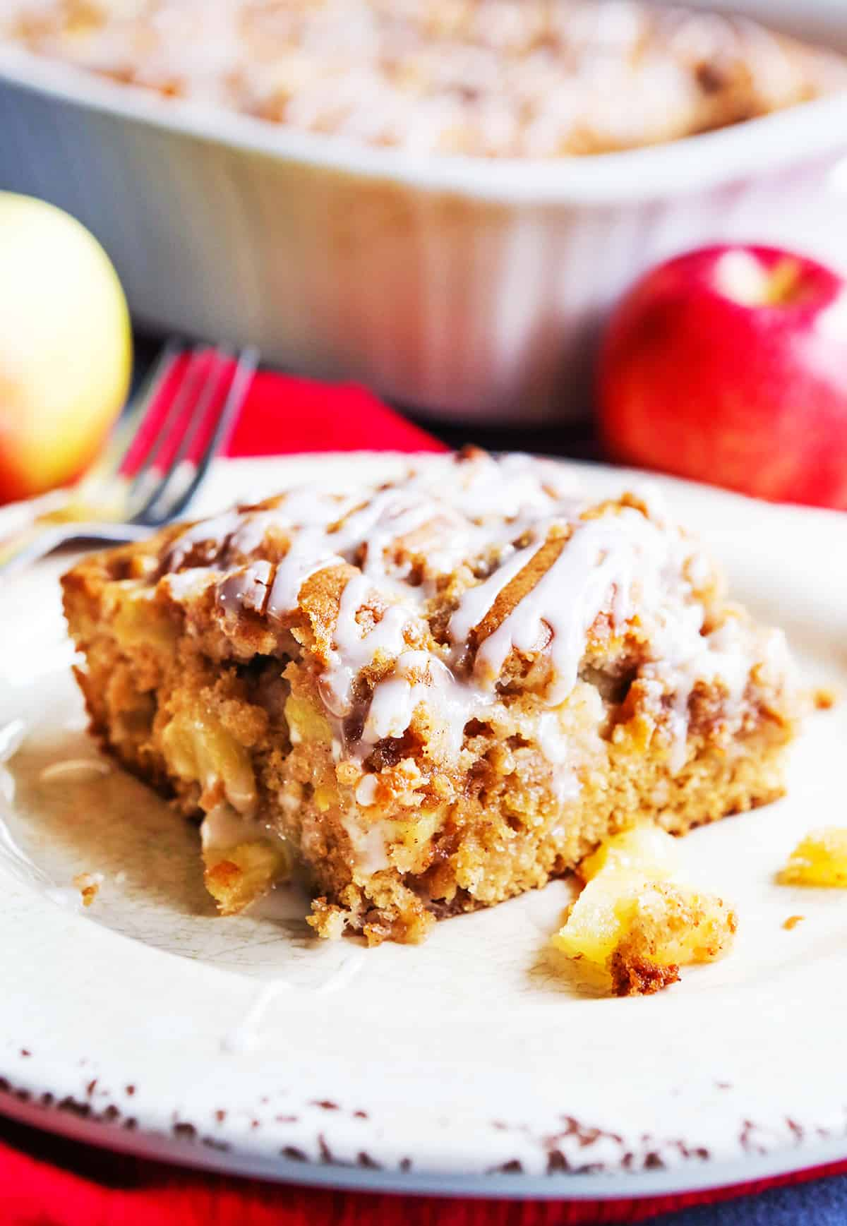 slice of apple coffee cake sitting next to pan.