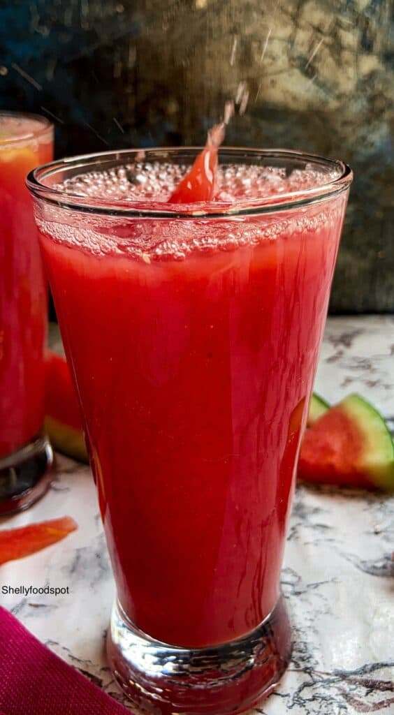 glass of red watermelon juice with a splash.