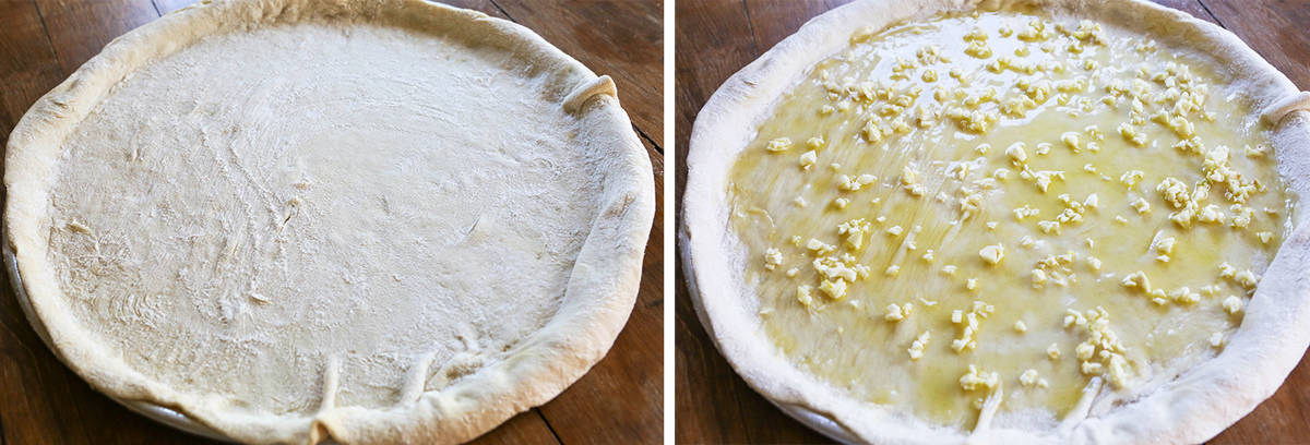 Pizza dough with garlic and oil spread over the top.