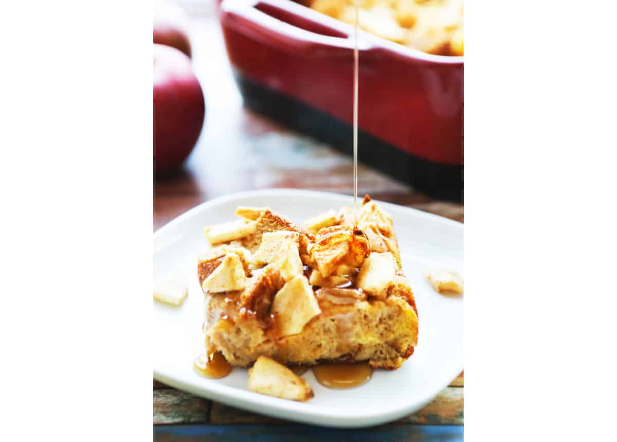 Syrup drizzling over a slice of apple french toast bake.