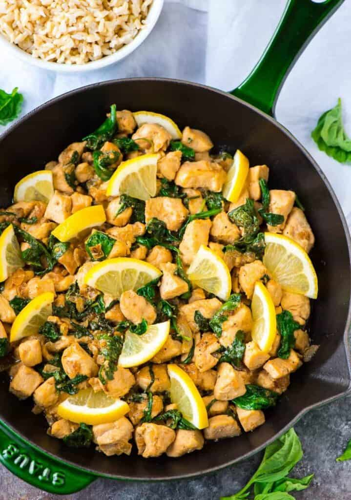 Lemon basil chicken prepared and sitting in a skillet.