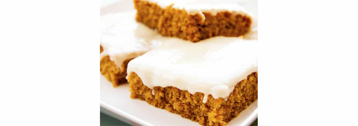 several frosted pumpkin bars up close.