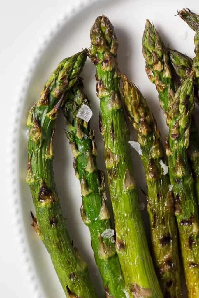 Platter of grilled asparagus ready to serve.