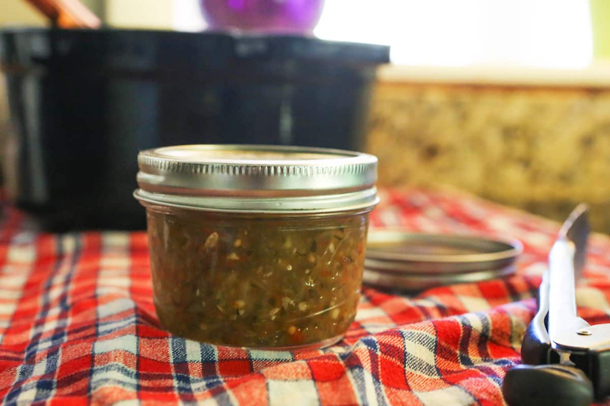 Jar of pickle relish on a kitchen towel.